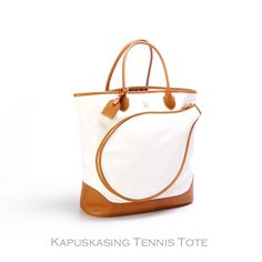 Whether playing tennis at the club or on your own private court in the Hamptons, the Kapuskasing Tennis Tote is perfect for you. With it's ultimate in old school chic design and gorgeous waterproof Italian coated canvas, this tote is exactly what you dreamed of. The elegant vachetta trim and richly saturated colors give the perfect attention to detail that really makes you covet this bag.