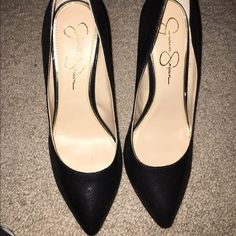 Jessica Simpson black snake fabric pumps . Black snake fabric. Worn once . It has a little scratch on both sides of shoes .can hardly see it . Great condition super cute shoes . A basic piece . Jessica Simpson Shoes Heels