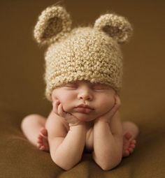 Bear hat outfit resting chin photo