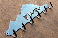 Sonoma Steel, Steel Running Medal Holder http://www.runnersworld.com/gift-guide/2015-gift-guide-for-runners-30-under-30/sonoma-steel-steel-running-medal-holder
