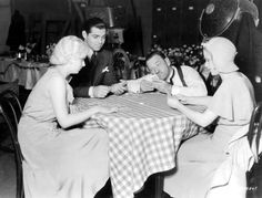 Jean Harlow, Clark Gable, Wallace Beery and Mary Carlisle play bridge on the set of The Secret Six