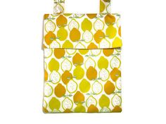 Add some color to your kitchen with this bright lemon and orange hanging wet bag! It is made with two snap (KAM snaps) straps to attach it to your