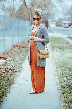 I love the burnt orange color and the casual but composed look. She has similar hair color and glasses style too.