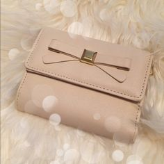 """Cream bow wallet Excellent condition except for a tiny spot on the inside fabric. Very small and can barely be seen in second image on the left side. Lots of compartments, button closure. Size 5""""x4"""".  no trades Bags Wallets"""