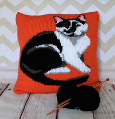 Knitted cushion cover pattern featuring a handsome black and white cat in a fun pop art style! This can be used to cover a cushion pad, or a box canvas if you'd prefer to display your hard work on the wall and have a unique piece of art!This animal / pet portrait knitting pattern features written instructions and an intarsia chart for the main picture.Finished piece measures 40x40cm knitted in one piece in Double Knitting yarn with a 5 button opening at the back when sewn upMaterials Req...