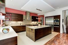 Kitchen with wood flooring, large island and contemporary design features