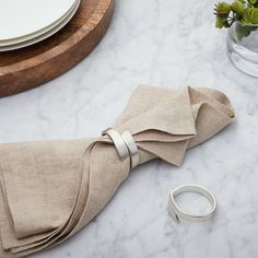 Wrap Silver Napkin Ring + Reviews | Crate and Barrel Modern Napkins, Black Napkins, Linen Napkins, Crate And Barrel, Christmas Table Linen, Christmas Time, Grey Dinner Plates, Silver Napkin Rings, Table Accessories