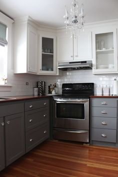 2 Tone Kitchen - Transitional - kitchen - Benjamin Moore Whale Gray - Modern Jane  Like two-toned cabinets, stove & exhaust fan. Not sure where fridge, microwave & type of flooring. Needs island.
