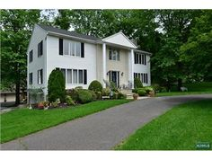 1024 Soldier Hill Rd, Emerson, NJ 07630 — custom built colonial***features found on homes of greater value*** Huge entry hall, large living room, banquet dining room with exquisite leaded glass window, fabulous cherry kitchen, jenn-aire, bar sink, breakfast area overlooking parklike yard, expansive family room with stone fireplace, master suite with fireplace, bath, sitting area, great closets, 3 generously proportioned bedrooms, beautiful main bath.  Roof 4 years old, central air 2…