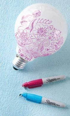 If you draw on a lightbulb with a Sharpie, you can have neat designs shine on the walls!