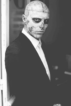 RICO THE ZOMBIE....even with the zombie tattoos on his face he is still good looking....besides it can't get much better than a tattooed man in a suit!!!!