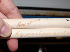 Laser engraved drum sticks - closeup