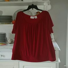 Red short sleeve shirt Red short sleeve shirt. Loose band around bottom of shirt rounded neck. Pleats on chest. 92% polyester and 8% spandex. 26 inches long. Worthington Tops Blouses