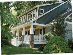 My house is going to be similar to this one: Shaker shingles, big front porch, bench swing, fans, nice ceiling.....
