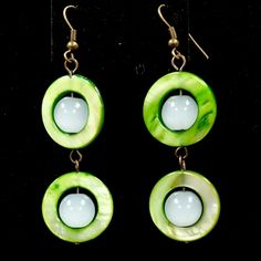 """These earrings reminds me  so much of those green granny smith apples! Hand-crafted with vibrant green circular shell beads, milky white glass beads & bronze colored ear wires.      If you live in Columbia, SC or close surrounding areas enter discount code COLA1 for FREE SHIPPING! Then message me or email me at beaded4belles@gmail.com to set up a """"Meet & Deliver"""". 