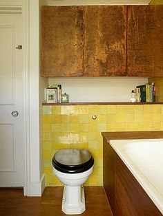 A soft yellow like Olivine, adds a just the right amount of color to a space. Pair with white a wood finishes for a look like this.