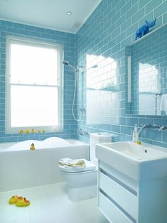 blue subway tile with white, modern family bathroom by Suzy Hoodless
