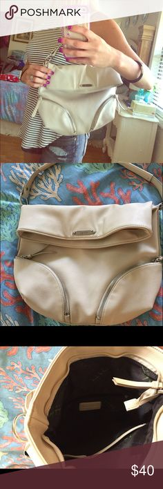 Nicole Miller beige purse. NWOT. Beige Nicole Miller fold down over the shoulder handbag. This is not her lower end line. Interior and exterior is flawless. Nicole Miller Bags Hobos