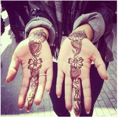 Henna flowers down middle finger