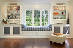 Kitchen:Window Seat Cushions Decorating Wall Bookcase Wall Open Shelves Glass Windows Decorative Ottoman Striped Wooden Floor White Cabinet With Bench Seat Building A Window Seat to Beautify Your Kitchen