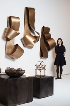 """""""When thinking about art, I like to introduce my clients to different media,"""" says Huh. """"The metallic art installation from Martha Sturdy was really a standout for me."""""""
