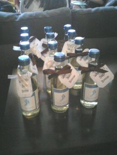 Now that's my kind of baby bottle! Saw this as a favor at a baby shower - such a cute idea. And Barefoot has different pretty colored bottle labels for their different varietals to match almost any theme.