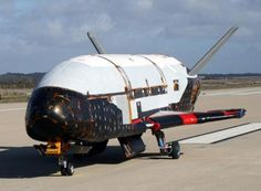 The X-37B spacecraft steered itself to a landing early Saturday. - It was up there for quite a while.  Wonder what it was doing?