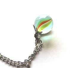 Marble jewelery vintage cats eye glass 1950s - 1960s playful. $17.00, via Etsy.