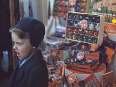 Rare color photos: Kids in the 1940s  1941 or 1942     Boy beside store window display of Christmas ornaments.