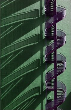 purple spiral staircase against a green wall. Grand Staircase, Staircase Design, Architecture Details, Interior Architecture, Building Architecture, Fire Escape, Take The Stairs, Stair Steps, Stairway To Heaven