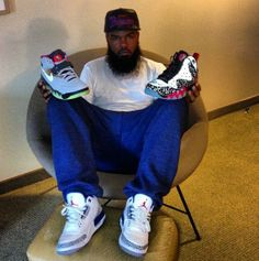 Stalley wearing Jordan Retro III- True Blue, Nike Air Force Max Max 180- Area 72, and Nike Barkley Posite Max