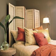 Via Southern Living. Love the room seperator used for angled bed headboard!