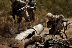 Members of the U.S. Army's 82nd Airborne Division inspect a bomb from the year of the Russian invasion of Afghanistan in hopes of being able to remove it from a cemetery. The bomb, a longtime concern for local residents, was too big to be removed with the equipment they had, so the task was left to be done on another day. June 6, 2010