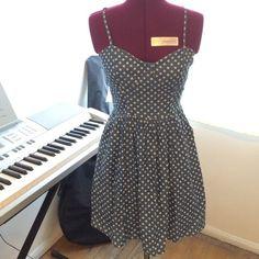 Blue polka dot denim dress Cute polka dot blue denim dress w/ side pockets. Bustier like top, zipper down the side. Forever 21, Size S Forever 21 Dresses Mini