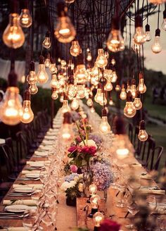 A fun way to brighten up a long table for your reception dinner - exposed light bulbs add an edgy rustic charm, which is offset by the floral centre pieces - the vintage wedding dream! Indian wedding decor - modern Indian wedding #thecrimsonbride