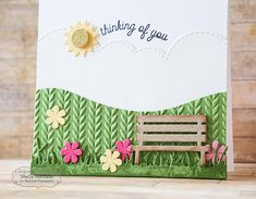 Park Bench—TE Little Bits die, Park Bench; Build a Scene Rolling Hills and Build a Scene Swirly Clouds; Cable Knit Embossing Folder; Wispy Grass and Little Bits Sun & Clouds and Little Bits Flowers & Stems