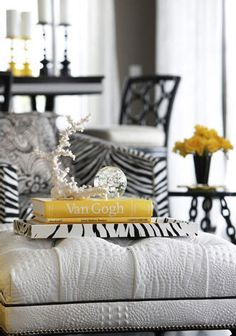 Liking this B & W combo, that super deep tufting! White Alligator leather ottoman?....zebra & canary