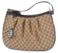 Gucci 364843 Canvas Gg Charm Sukey New Hobo Bag. Hobo bags are hot this season! The Gucci 364843 Canvas Gg Charm Sukey New Hobo Bag is a top 10 member favorite on Tradesy. Get yours before they're sold out!