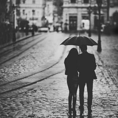 Standing in the rain together.