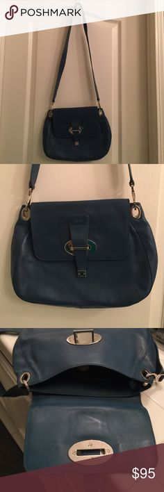 Tod's leather cross body bag Authentic Tod's leather cross body bag in near perfect condition. I see no noticeable flaws or imperfections.. Beautiful deep blue leather with tan cloth interior. Silver tone hardware. Zippered interior back side pocket with media slots to opposite side. A truly stunning very high end bag, perfect for running errands since it's light weight. Tod's Bags Crossbody Bags