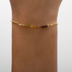 gold dipped sterling silver chain with 18 brown ombre tourmalines. logo charm contains a tiny diamond. Gold Dipped, Sterling Silver Chains, 18k Gold, Gems, Charmed, Logo, Diamond, Brown, Bracelets