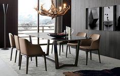 Pour rendre encore plus élégante et classe la salle à manger moderne,vous pourriez l'aménager et la décorer avec des meubles et accessoires sombres.Le mélan