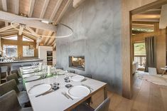 Minimal and elegant interior of the chalet-style French home with large dining space