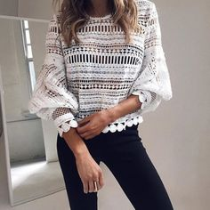 We adore the detail of this white crochet shirt. Especially the big scalloped cuffs!