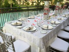 Poolside reception at Now Larimar Punta Cana. We love these centerpieces! #NowLarimar #PuntaCana #DestinationWedding