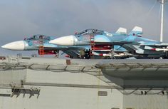 Russians show off aircraft carrier Admiral Kuznetsov with SU-33 Flanker jets as massive offensive in Syria begins