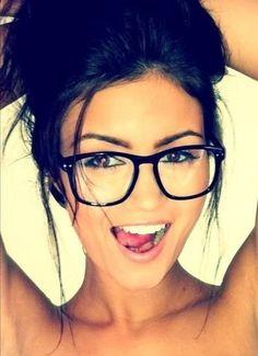 big glasses on girl posing for it .