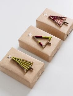 Bring new life to discarded twigs by wrapping them in yarn and using them to top your Christmas presents