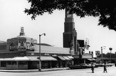 The corner of Degnan and 43rd in 1968, 1 year after Alonzo and Dale Davis opened Brockman Gallery. In the background the art deco Leimert Theatre, now the Vision, originially designed by the architectural firm Morgan, Walls & Clements | Photo: Courtesy of Los Angeles Public Library