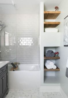 Bathroom, white subway tile, mosaic floor tile, glass shower tub, wood shelving / Carriage Lane Design-Build Inc. Upstairs Bathrooms, Basement Bathroom, Master Bathroom, Small Bathrooms, Modern Bathroom, Bathroom Ideas White, White Bathroom Shelves, Small Bathroom With Tub, Master Tub
